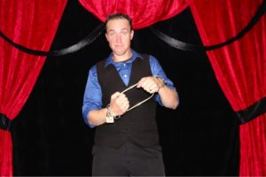 Photo of magician doing magic trick
